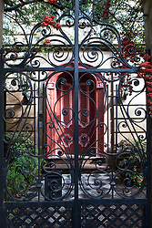 Wrought iron gate and red door, Charleston, South Carolina, United States of America