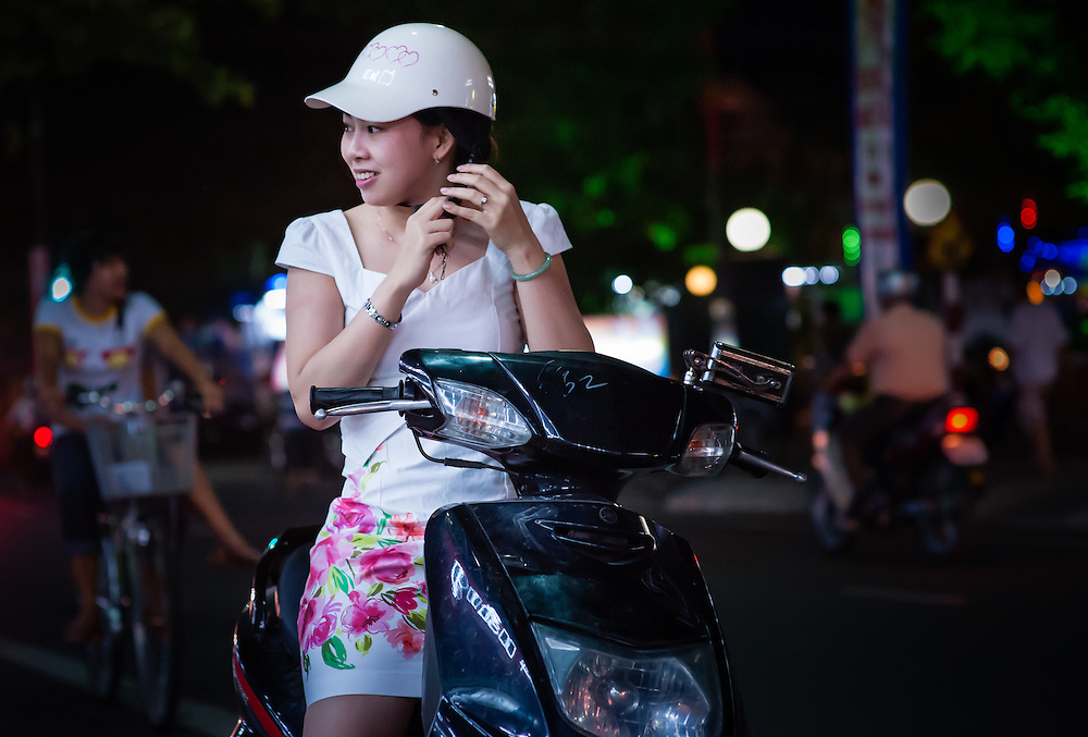 Young woman on motorbike with white helmet (Vietnam)