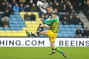 West Bromwich Albion defender Dara O'Shea (27) battles for possession with Millwall midfielder Jed Wallace (7) during the EFL Sky Bet Championship match between Millwall and West Bromwich Albion at The Den, London, England on 9 February 2020.