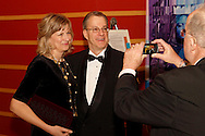 Volunteer Paul Kulback takes a picture of Anne & Roger Jones of Centerville before the 10th Anniversary Concert at the Schuster Center in downtown Dayton, Friday, March 1, 2013.