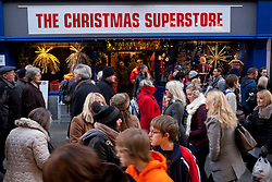 © Licensed to London News Pictures.09/12/2012. Lincoln,UK. On one of the busiest shopping weekends before Christmas, shoppers pack the streets of Lincoln. Pictured, a Christmas Superstore in High Street, Lincoln. Photo credit : Dave Warren/LNP