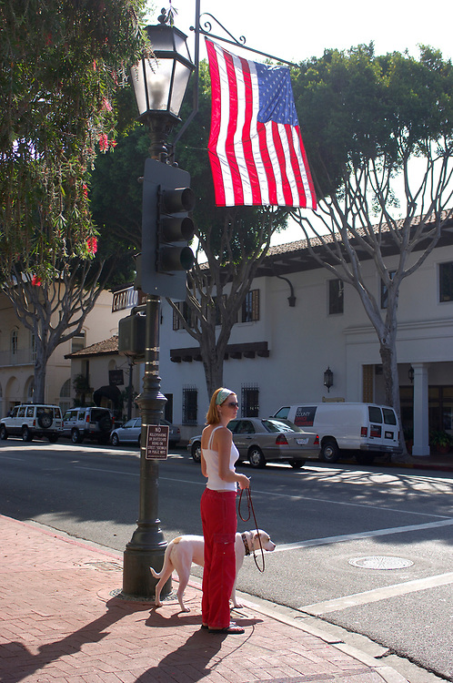 Woman with dog at State Street, Downtown, Santa Barbara, California, United States of America