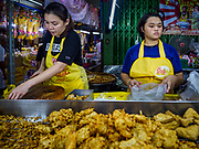 20 OCTOBER 2017 - BANGKOK, THAILAND: Women sell vegetarian food in Talat Noi neighborhood of Chinatown in Bangkok on the first day of the Vegetarian Festival, what Thais call the Taoist Nine Emperor Gods Festival, in the Chinatown neighborhood of Bangkok, Thailand. It is a nine-day Taoist celebration beginning on the eve of 9th lunar month of the Chinese calendar. For nine days people participating in the festival wear only white and don't eat meat, poultry, seafood, and dairy products. The vegetarian festival is celebrated throughout Thailand, but especially in Phuket and Bangkok, cities with large ethnic Chinese communities.       PHOTO BY JACK KURTZ