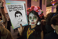 The British Museum, London, UK. 30th October, 2015.  Up to 50 Mexican and British activists joined together to mount a performance-protest during the British Museum's 'Day of the Dead' festival. The evening event, co-sponsored by BP and the Mexican government, are accused of playing host to a 'deadly partnership' which is covering up a host of human rights and environmental abuse. The protest was co-organised by the London Mexico Solidarity Group and theatrical protest group BP or not BP?  The activists also accuse the Mexican government of trying to distract attention from human rights abuses - including the disappearance a year ago of 43 students - and of co-opting arts and culture to attract foreign investors to its newly-privatised oil and gas sector. The British Museum event – part of a four-day Days of the Dead celebration – is part of the Dual Year of UK and Mexico 2015, 'a year-long celebration of cultural, educational and business exchange' between the two nations. // Lee Thomas, Flat 47a Park East Building, Bow Quarter, London, E3 2UT. Tel. 07784142973. Email: leepthomas@gmail.com. www.leept.co.uk (0000635435)