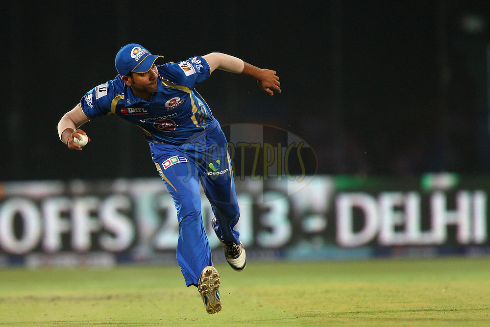 Rohit Sharma fields during the qualifier 1 match of the 2013 Pepsi Indian Premier League between The Chennai Superkings and the Mumbai Indians held at the Feroz Shah Kotla Stadium, Delhi on the 21st May 2013..Photo by Ron Gaunt-IPL-SPORTZPICS    ..Use of this image is subject to the terms and conditions as outlined by the BCCI. These terms can be found by following this link:..http://www.sportzpics.co.za/image/I0000SoRagM2cIEc