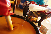 Women mix ingredients to make shea butter soap at the Si Yiriwa shea processing center in the town of Diolila, Mali on Friday January 15, 2010.