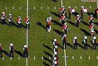 Mr. Wuf howls at mid-field along with marching band prior to the start of a football game in Carter-Finley Stadium.   PHOTO BY ROGER WINSTEAD