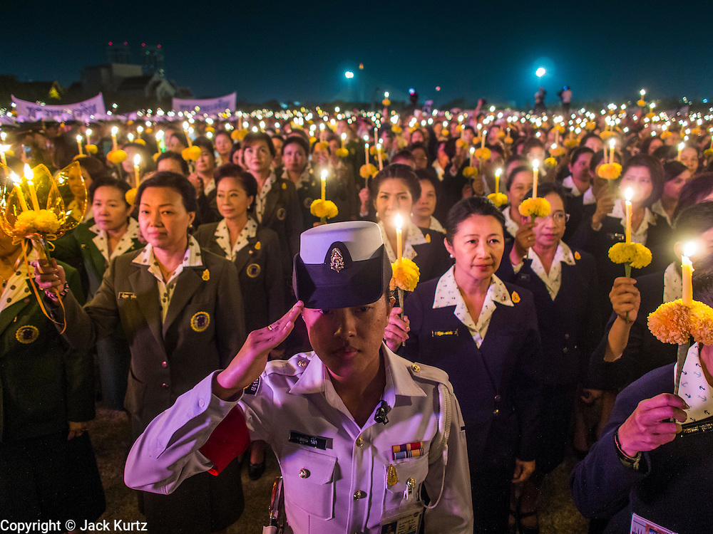 Thai civil servants hold candles during a candlelight service for the King. Thais observed the 86th birthday of Bhumibol Adulyadej, the King of Thailand, their revered King on Thursday. They held candlelight services throughout the country. The political protests that have gripped Bangkok were on hold for the day, although protestors did hold their own observances of the holiday. Thousands of people attended the government celebration of the day on Sanam Luang, the large public space next to the Grand Palace in Bangkok.