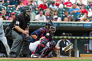 Making his MLB debut, Chris Herrmann #23 of the Minnesota Twins takes a foul tip to the face mask during a game against the Chicago White Sox on September 16, 2012 at Target Field in Minneapolis, Minnesota.  The White Sox defeated the Twins 9 to 2.  Photo: Ben Krause
