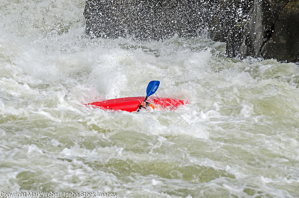 Adam Majors kayaking the Drop which is rated Class 5 on the Milner Mile section of The Snake River near the town of Murtaugh in southern Idaho