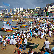 Participants of the Festa de Iemanjá, or Festival of Yemayá, take to the beaches of the neighborhood of Rio Vermelho, in Salvador, Brazil. The festival is a celebration of the Candomblé deity, or orixás, Iemenjá, who is a goddess of the sea and embodies the feminine principle.  The religious bring offerings to Iemenjá, which are sent out to sea and dropped in the water by boats waiting on the shore for this purpose. It is believed that offerings which are not returned to shore by the sea over the following days are deemed accepted by Iemenjá. Photo by Jen Klewitz