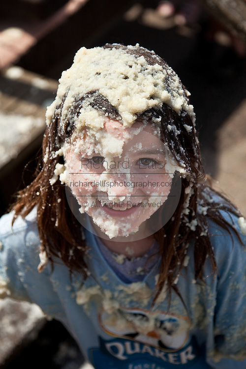 ST GEORGE, SC - APRIL 17: A young girl smiles after rolling around in a giant vat of grits during the World Grits Festival April 17, 2010 in St. George, South Carolina. Among the various events for the festival is the Rolling in the Grits for children where the winner is the one who can hold the most of grits to their body. Grits is corn-based porridge common in the Southern United States.   (Photo Richard Ellis)