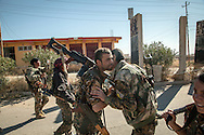 13/11/2015-- Iraq,Sinjar -- YPG fighters greeting each other after seeing each other again after the fight.