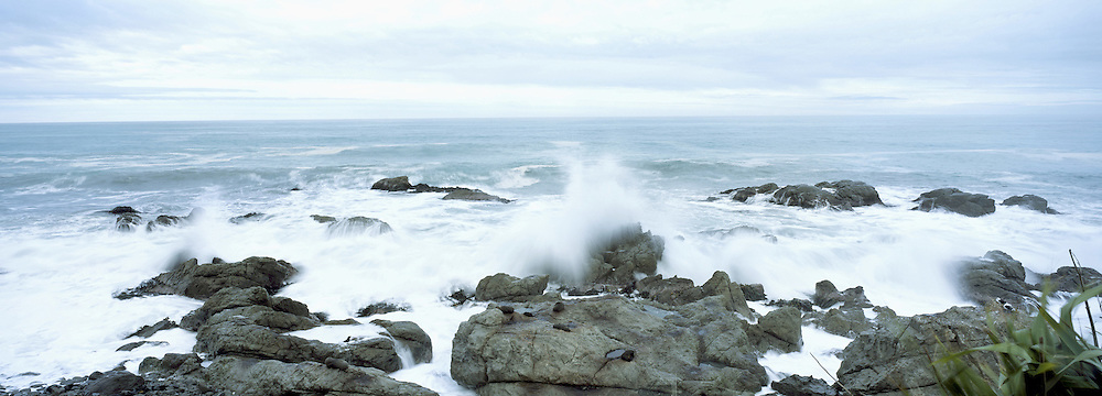 Sea breaking over rocks on the East coast on the South Island of New Zealand