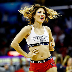 Mar 3, 2017; New Orleans, LA, USA; A member of the New Orleans Pelicans dance team performs during the second half of a game against the San Antonio Spurs at the Smoothie King Center. The Spurs defeated the Pelicans 101-98 in overtime. Mandatory Credit: Derick E. Hingle-USA TODAY Sports