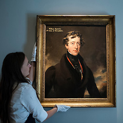 "© Licensed to London News Pictures. 06/07/2015. London, UK.  A Sotheby's technician shows Sir Thomas Lawrence's ""Portrait of William Spencer Cavendish, 6th Earl of Devonshire"" (est. £300k to £500k) at the preview of Old Masters, British Paintings and Masterworks from the collection of Castle Howard at Sotheby's ahead of the auction on July 8. Photo credit : Stephen Chung/LNP"