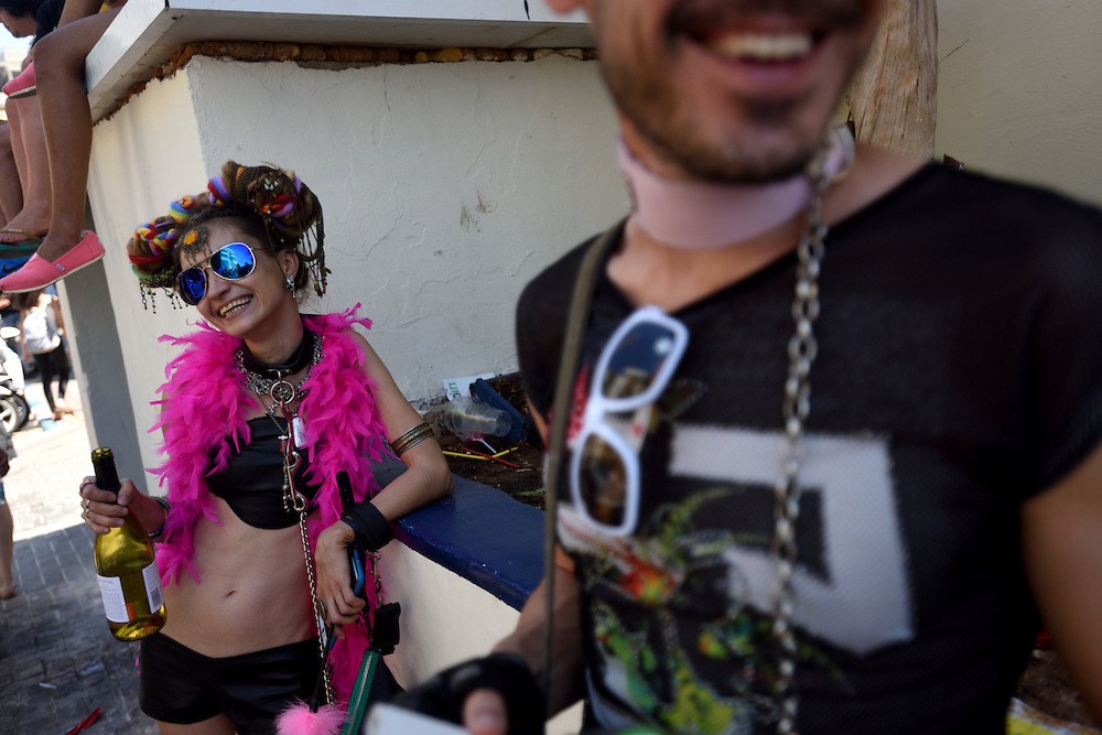 TEL -AVIV, ISRAEL - June 12, 2015: A couple dressed in sexy costumes attend the Annual Gay Pride Parade took place in Tel-Aviv, attracting thousands of participants from all over the world. Photo by Gili Yaari