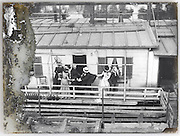 family having fun in front of their houseboat Paris early 1900s