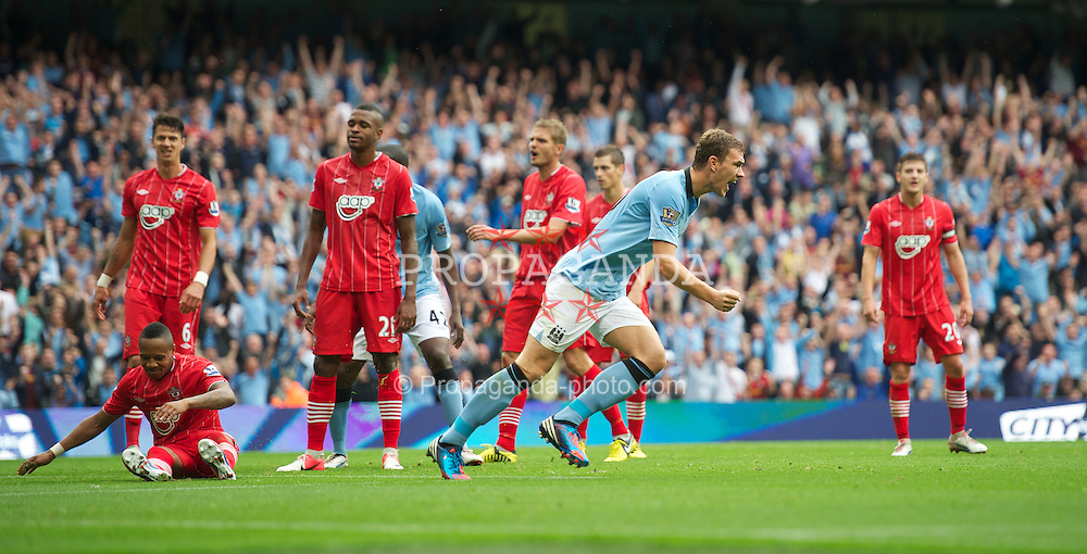 MANCHESTER, ENGLAND - Sunday, August 19, 2012: Manchester City's Edin Dzeko celebrates scoring the second goal against Southampton, to level the scores 2-2, during the Premiership match at the City of Manchester Stadium. (Pic by David Rawcliffe/Propaganda)