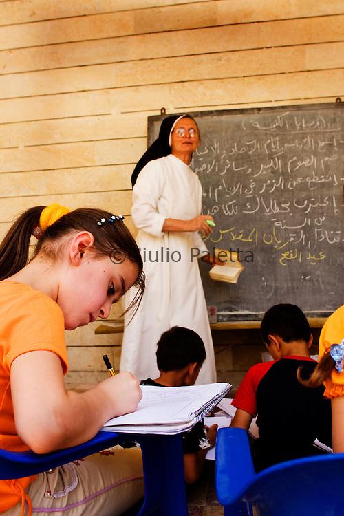 A Catholic Nun teaching Arabic