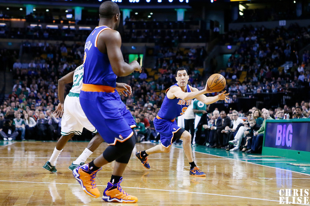 26 March 2013: New York Knicks point guard Pablo Prigioni (9) passes the ball to New York Knicks point guard Raymond Felton (2) during the New York Knicks 100-85 victory over the Boston Celtics at the TD Garden, Boston, Massachusetts, USA.