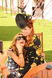 Left to right, CAT DEELEY and PALOMA FAITH at the Cartier International Polo at Guards Polo Club, Windsor Great Park, Berkshire on 25th July 2010.