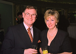 MR & MRS GRAHAM MORRIS, he is chief executive of Rolls-Royce, at a party in London on 19th March 1998.MGD 12