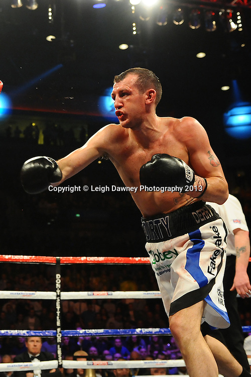 Derry Matthews fights Anthony Crolla (draw) in a 12x3 min bout for the Commonwealth Lightweight Title at the Echo Arena, Liverpool, London, UK on the 30th March 2013. Matchroom Sport © Leigh Dawney Photography 2013.