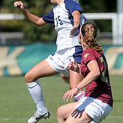 UNCW's Lindsey Byrne heads the ball away from Elon's Marissa Russo Sunday October 5, 2014. (Jason A. Frizzelle)