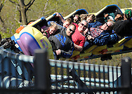 Guests ride the roller coaster during a Variety Club event at Sesame Place Sunday April 24, 2016 in Langhorne, Pennsylvania. Sesame Place opens for the season April 30, 2016. (Photo by William Thomas Cain)