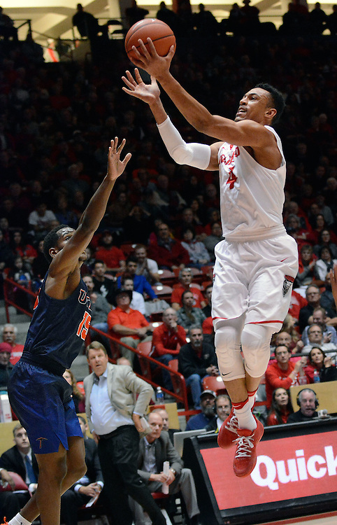 jt120716f/sports/jim thompson/UNM's #4 Elijah Brown  head to the hoop with UTEP's # 15 Dominic Artis looking to prevent the shot.  Wednesday Dec. 07, 2016. (Jim Thompson/Albuquerque Journal)