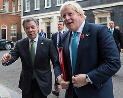 © Licensed to London News Pictures. 02/11/2016. London, UK. President of Colombia, Juan Manuel Santos Calderón leaves number 10 Downing Street accompanied by Foreign Secretary, Boris Johnson. Photo credit : Stephen Chung/LNP