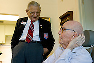 World War I Veteran Harry Landis, 107, at home in Sun City Center.  Landis is one of only four known surviving veterans of WWI.  Pictured, Cmdr. Ed Socha (ret.) of the Military Officers Association of America shares a laugh with Landis.