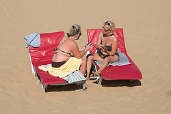 @Licensed to London News Pictures 13/09/16. Margate Sands Beach, Margate, Kent. Local residents enjoying very unusual high temperatures today on Margate Sand main beach in Kent. Temperatures could soar to record levels for the hottest September day in 50 years.Photo credit: Manu Palomeque/LNP