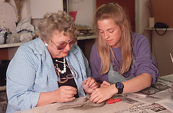 Woman with visual impairment learning pottery at the Institute for the Blind,