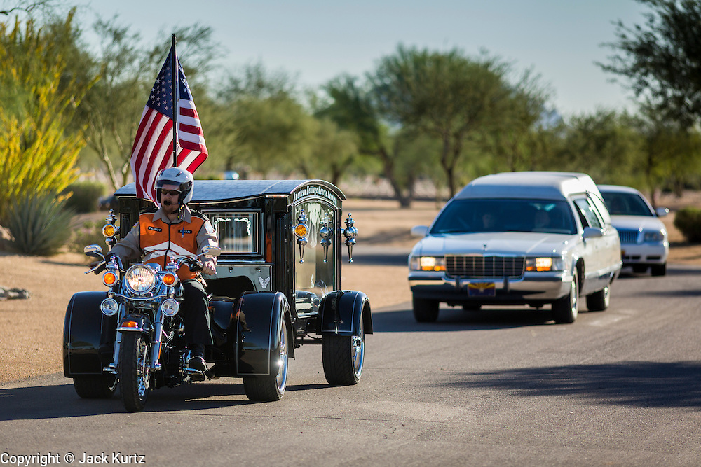 08 OCTOBER 2013 - PHOENIX, AZ: Hearses bearing the cremated remains of US military veterans enter the National Memorial Cemetery in Phoenix. The cremated remains of 36 unclaimed US military veterans were interred at the National Memorial Cemetery in Phoenix. Members of the US military and several hundred veterans of the US military attended the service, which was a part of the Missing In America Project (MIAP).    PHOTO BY JACK KURTZ