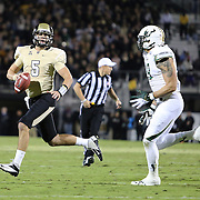 UCF Knights quarterback Blake Bortles (5) runs during an NCAA football game between the South Florida Bulls and the 17th ranked University of Central Florida Knights at Bright House Networks Stadium on Friday, November 29, 2013 in Orlando, Florida. (AP Photo/Alex Menendez)