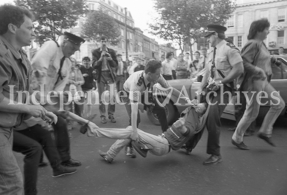 Gardai remove one of the protestors taking part in the anti-extradition protest at the unveiling of the Anna Livia Statue in Dublin's O'Connell St, June 1988 (Part of the Independent Newspapers Ireland/NLI Collection).