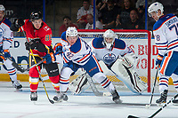 PENTICTON, CANADA - SEPTEMBER 8: Lane Bauer #42 of Edmonton Oilers clears the zone while checked by Andrew Mangiapane #88 of Calgary Flames during second period on September 8, 2017 at the South Okanagan Event Centre in Penticton, British Columbia, Canada.  (Photo by Marissa Baecker/Shoot the Breeze)  *** Local Caption ***