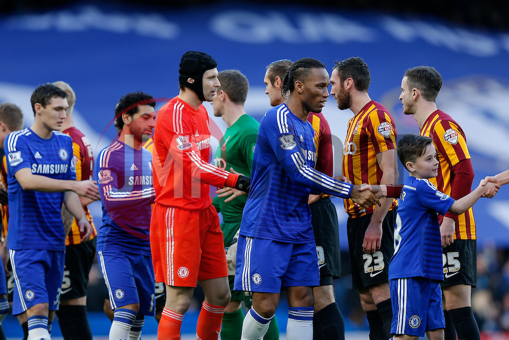 Captain Didier Drogba of Chelsea leads his side as they greet the Bradford City team before kick off - Photo mandatory by-line: Rogan Thomson/JMP - 07966 386802 - 24/01/2015 - SPORT - FOOTBALL - London, England - Stamford Bridge - Chelsea v Bradford City - FA Cup Fourth Round Proper.