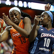 UNCASVILLE, CONNECTICUT- JUNE 3:  Chiney Ogwumike #13 of the Connecticut Sun rebounds while challenged by Matee Ajavon #10 of the Atlanta Dream  during the Atlanta Dream Vs Connecticut Sun, WNBA regular season game at Mohegan Sun Arena on June 3, 2016 in Uncasville, Connecticut. (Photo by Tim Clayton/Corbis via Getty Images)