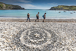 Pebble sculpture at Lulworth Cove in Dorset