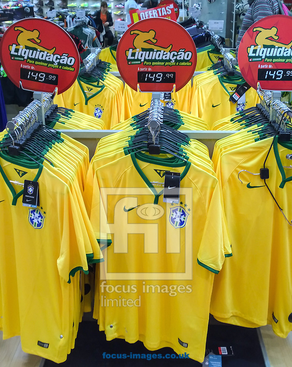 Brazil team football shirts on sale at a discount (R$149 is about &pound;39, down from about &pound;60) in a  sports goods store in the Botafogo district of  Rio de Janeiro, Brazil. Picture by Andrew Tobin/Focus Images Ltd +44 7710 761829<br /> 11/07/2014