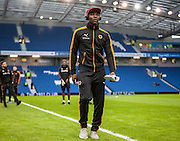 Wolverhampton Wanderers striker Benik Afobe makes himself famliar with the pitch before the Sky Bet Championship match between Brighton and Hove Albion and Wolverhampton Wanderers at the American Express Community Stadium, Brighton and Hove, England on 1 January 2016. Photo by Bennett Dean.