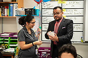Area Superintendent Geovanny Ponce interrupted class to announce  Ana Maria Steen,Navarro Middle School teacher, as the Sterling McCall VIP Services Teacher of the Month for February.