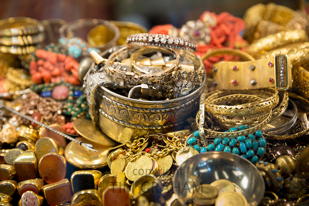 Gold jewelry rings bracelets bangles beads in The Grand Bazaar, Kapalicarsi, great market,  Beyazi, Istanbul, Turkey