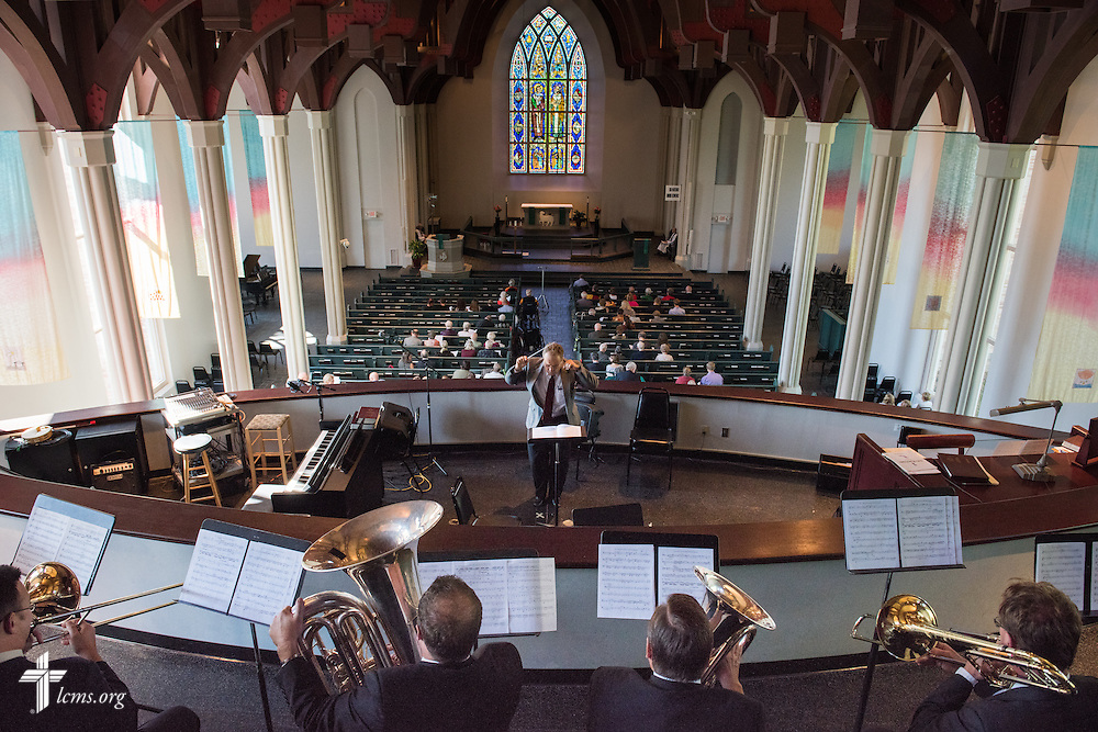 Dr. Martin Dicke leads a brass ensemble during a Mission Festival Service at the Chapel of St. Timothy and St. Titus shortly before the public opening of Concordia Historical Institute's museum exhibit 'Bringing Christ to the Highlands' in Papua New Guinea on Sunday, Oct. 5, 2014, on the campus of Concordia Seminary in Clayton, Mo. LCMS Communications/Erik M. Lunsford
