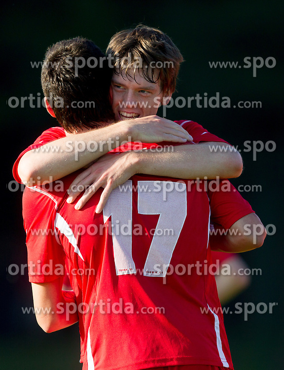 David Lonzaric and Alen Ploj of Aluminij celebrate during football match between NK Aluminij Kidricevo and NK Roltek Dob in 27th, last Round of 2nd SNL, on May 19, 2012 in Sports park Kidricevo, Slovenia. NK Aluminij defeated NK Dob 2-1, won 2nd SNL and qualified to 1st SNL. (Photo by Vid Ponikvar / Sportida.com)