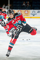 KELOWNA, CANADA - NOVEMBER 8: Nick Merkley #10 of Kelowna Rockets takes a shot during warm up against the Vancouver Giants on November 8, 2014 at Prospera Place in Kelowna, British Columbia, Canada.   (Photo by Marissa Baecker/Shoot the Breeze)  *** Local Caption *** Nick Merkley;