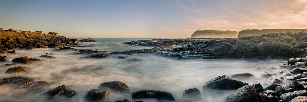 A panoramic of golden light at Curio Bay, Catlins, Southland, New Zealand